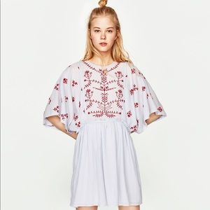 Full-bodied dress with embroidered details